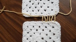And work back and forth (as if you are lacing your shoes!) and when you reach the half way point, you will take both ends of your yarn strand, on left and right side, and pull tightly all strands together until closed.